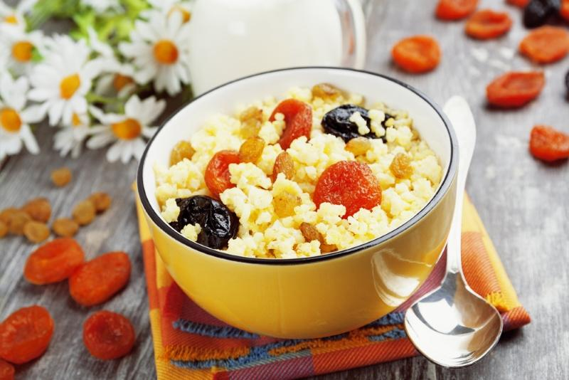 millet-porridge-with-dried-apricots-and-prunes-in-a-bowl