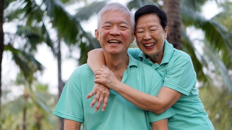 close-up-potrait-of-asian-senior-couple-on-bright-green-background