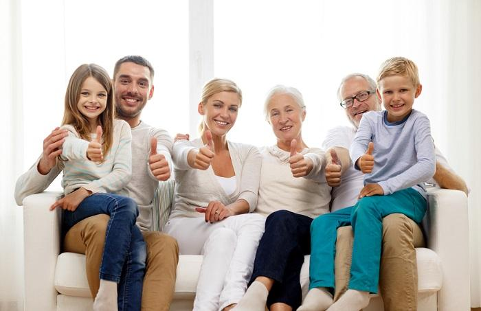 happy-family-sitting-on-couch-at-home