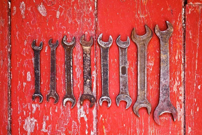 old-wrenches-on-the-floor-stained-with-red-paint
