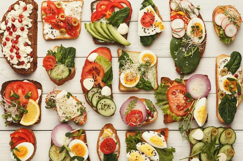 variety-of-healthy-vegetarian-sandwiches-on-white-wood-top-view
