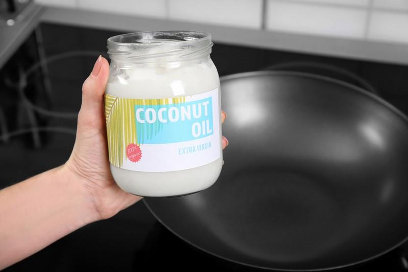 female-hand-holding-jar-with-coconut-oil