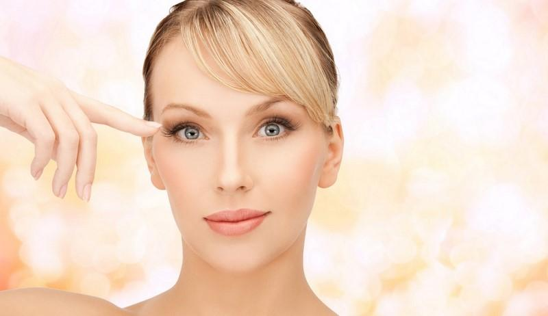 health-spa-and-beauty-concept-face-of-beautiful-woman-touching-her-eye-area