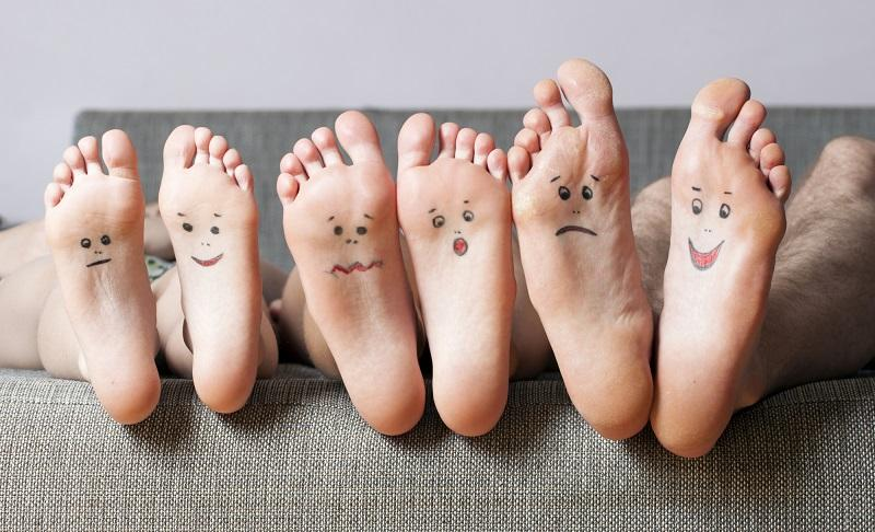 close-up-of-human-soles-with-smiles