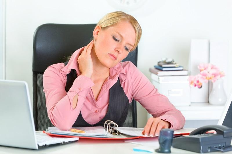 tired-business-woman-sitting-at-office-desk-and-working-with-financial-docu