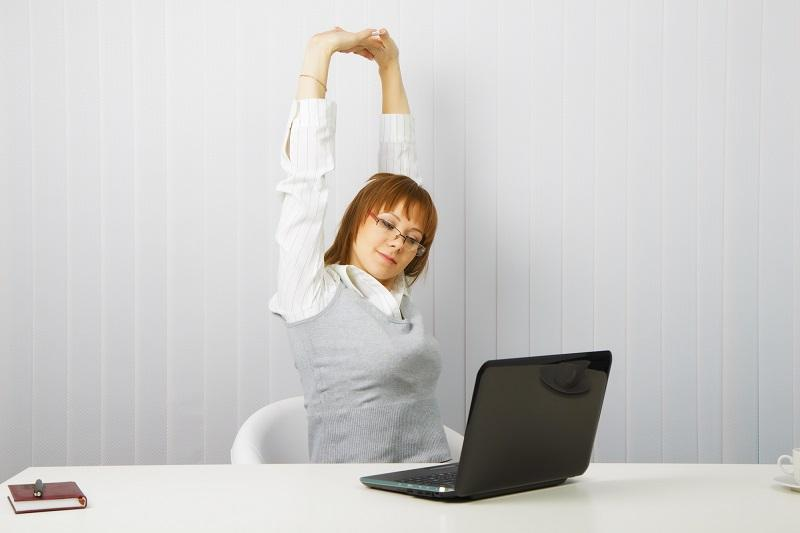 tired-girl-with-a-laptop-stretches