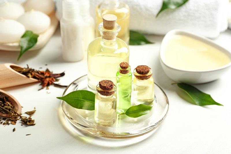 spa-composition-with-tea-tree-oil-on-white-background