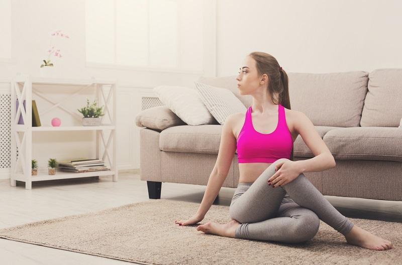 woman-training-yoga-in-twisting-sage-pose-2
