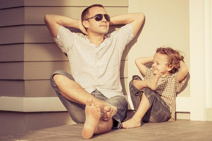 dad-and-son-playing-near-a-house