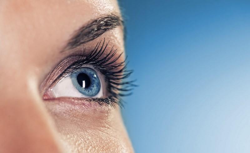 eye-on-blue-background-shallow-dof